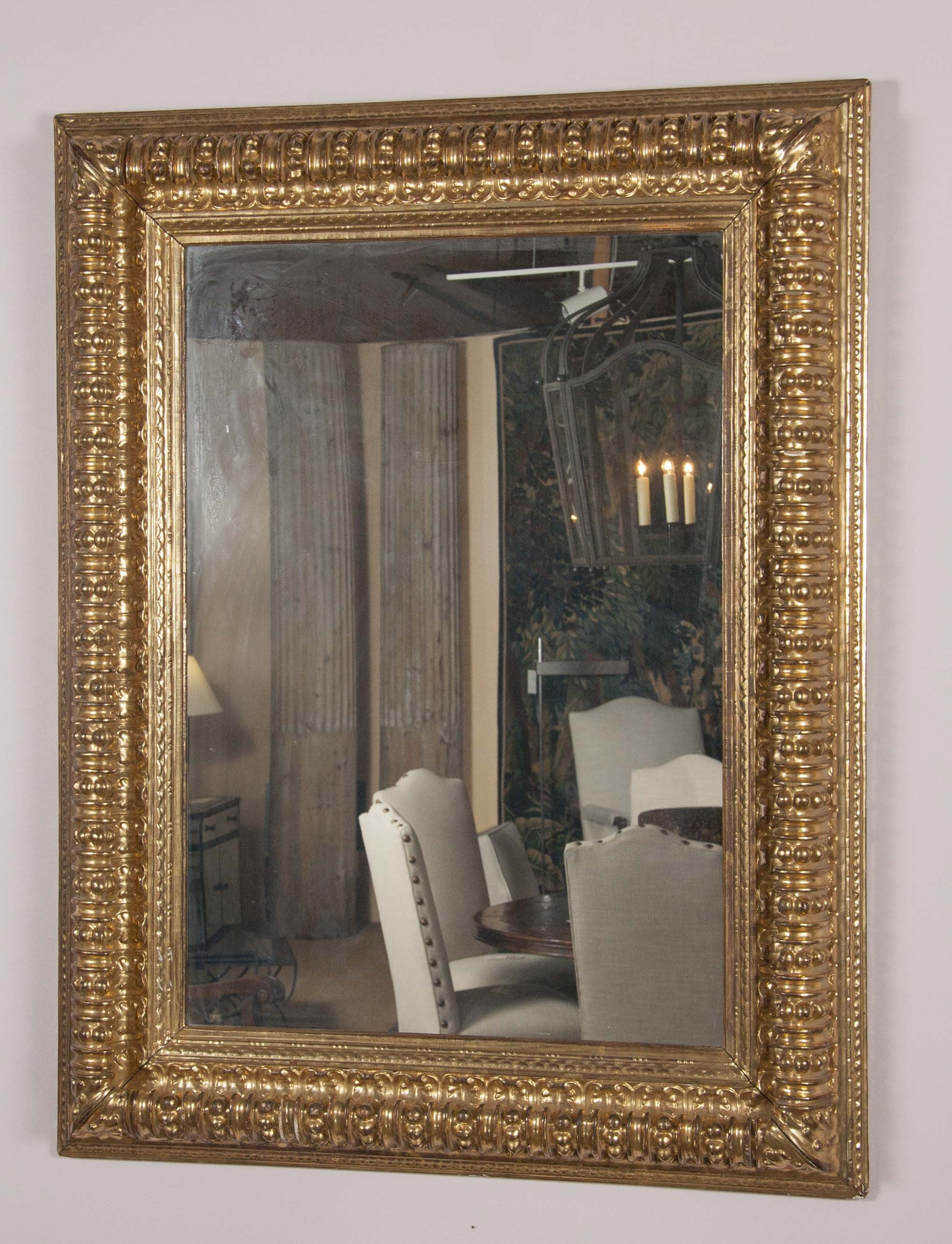A Large Gilt Gadrooned Mirror