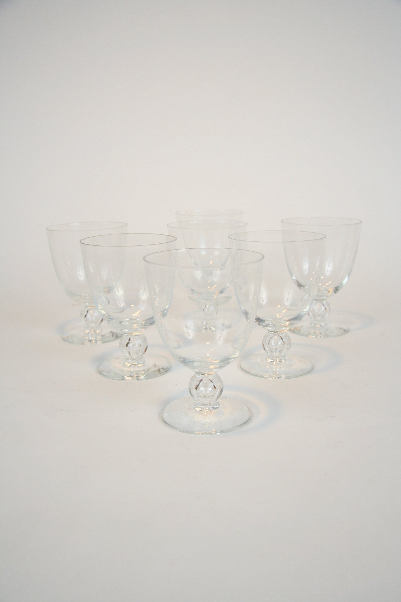 A Set of Seven Pre-War Steuben Air Bubble Wine Glasses Priced individually.