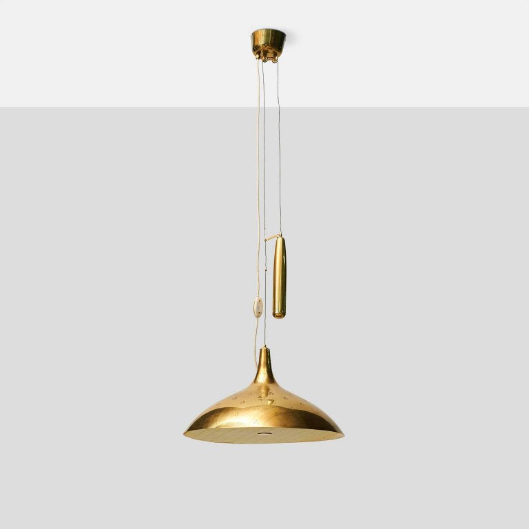 A large counter weighted Chandelier by Paavo Tynell for Taito Oy
