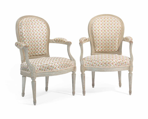 A Pair of Louis XVI grey painted armchairs by Henri Jacob