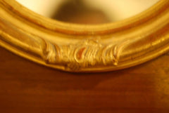A pair of French Antique Gold Leaf Mirrors