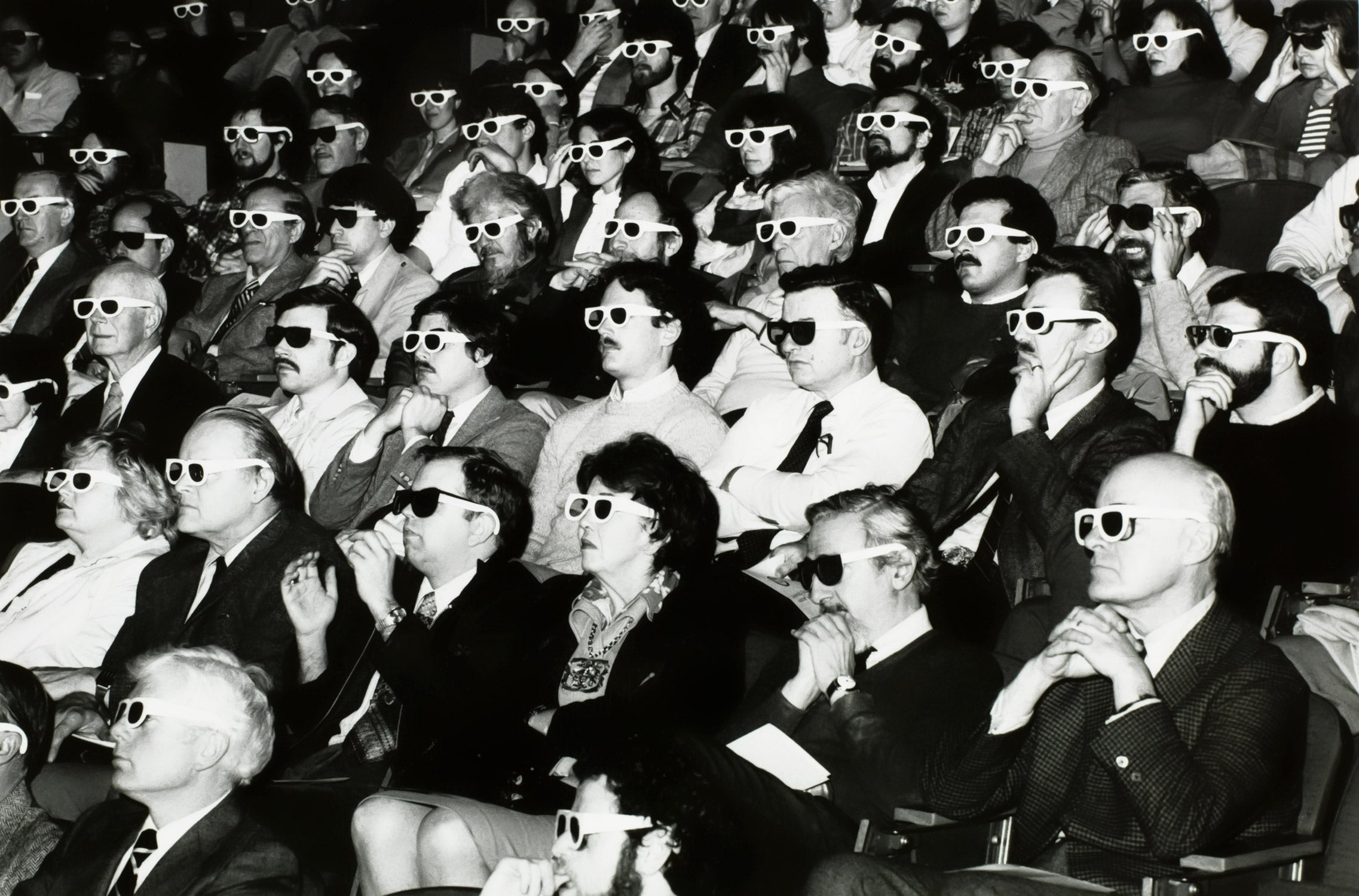 Movie theatre audience with 3d glasses