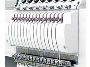 Tajima TFSN-912 9-Needle 12-Head Flat Bed Embroidery Machine