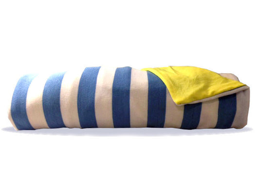 Seaward Blanket, Soft white and light blue stripes compliment a solid bright yellow backing. Ahoy, mateys!