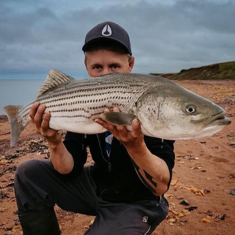 Mackenzie Sapier Hauls in Nice Striped Bass! - TLO Outdoors