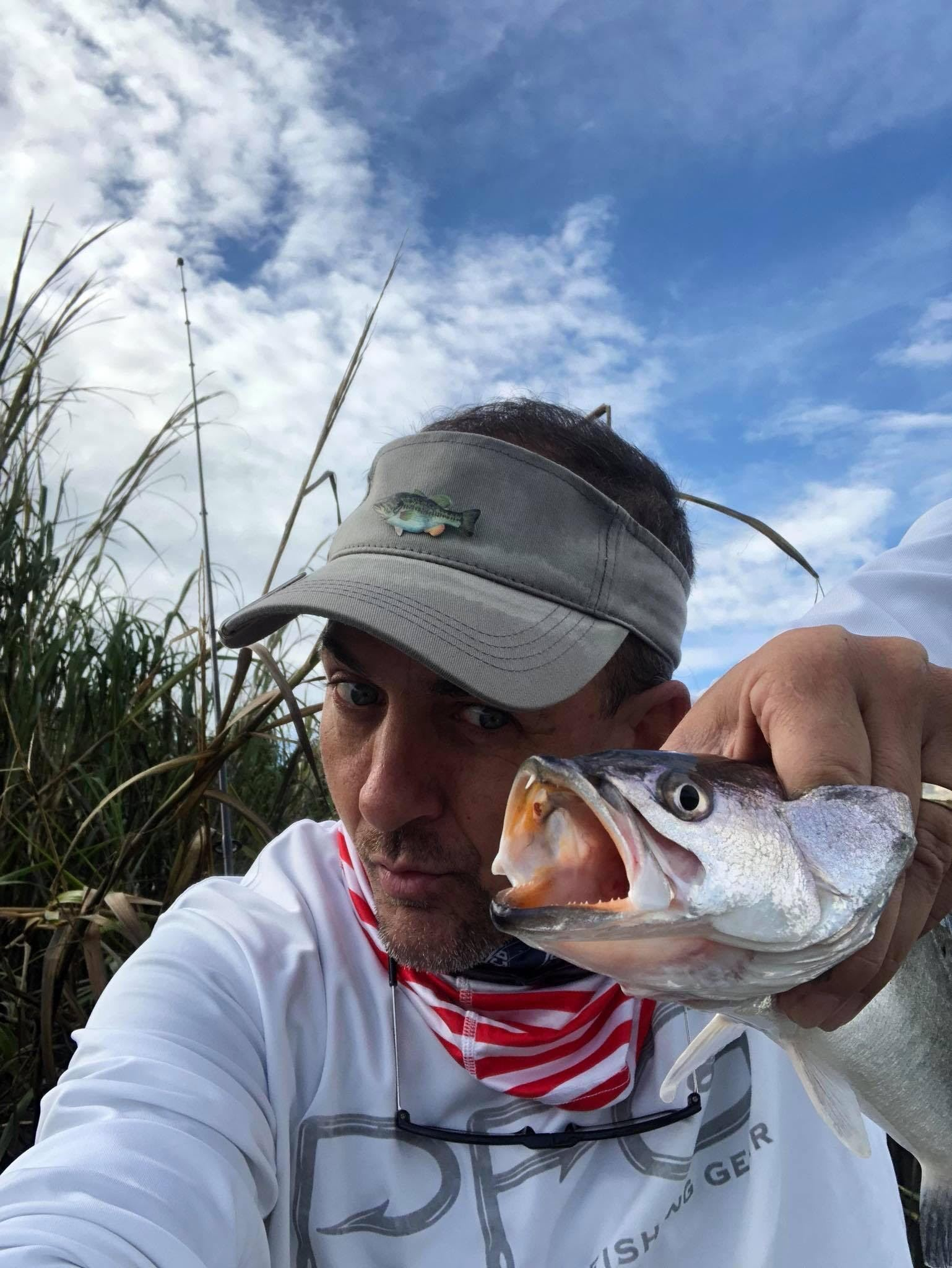 Chris Newburn Takes Selfie With a Fish - TLO Outdoors