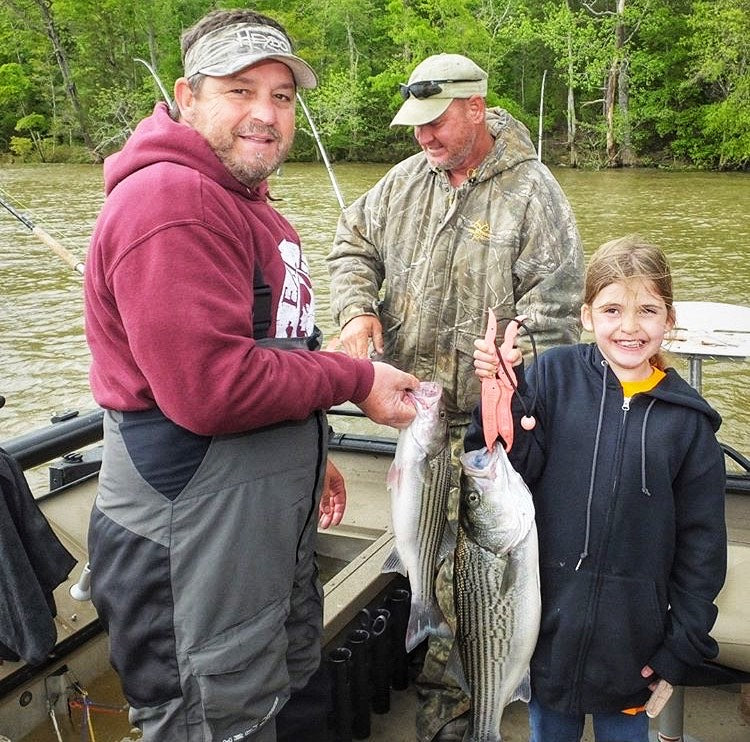 Young Girl Catches First Stripe Bass