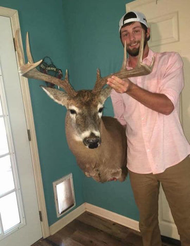 Devin Knight Holding his Mounted Buck