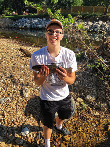 Sam Holding up the Rainbow Trout