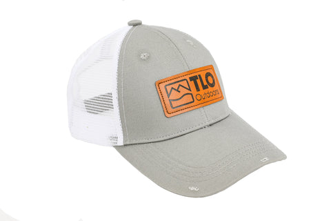 bc270976de6359 Rugged, Distressed-Style Snapback Trucker Cap with Leather TLO Outdoors  Logo Patch