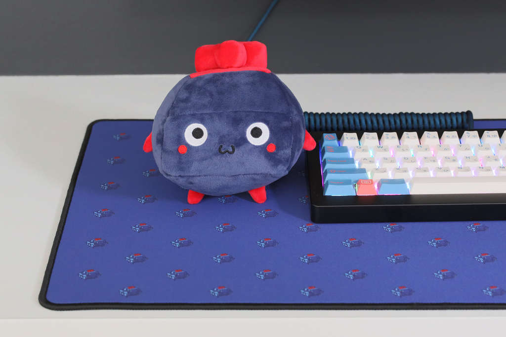 Blue and red plushie of a keyboard switch