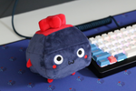 Key Plushie and Deskmat