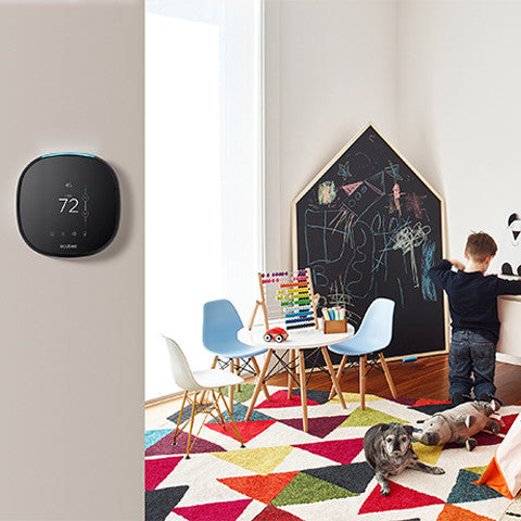 ecobee4 thermostat shown on a wall next to room where a child is playing.