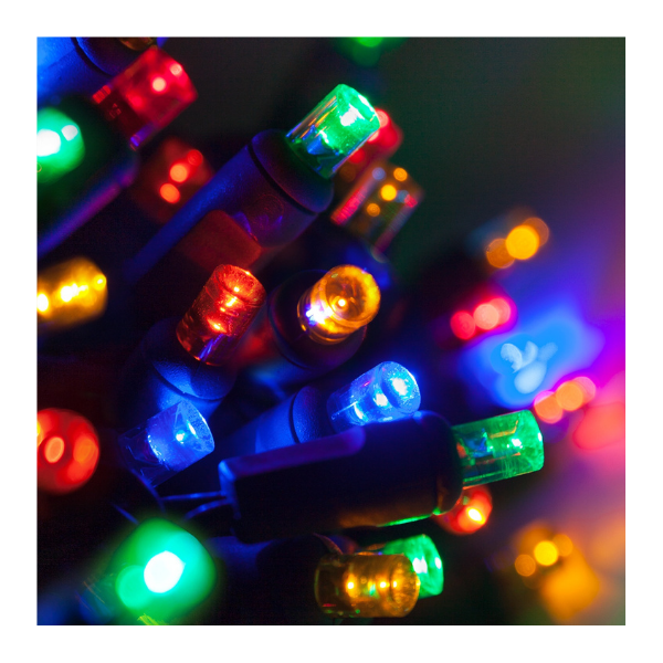 A close-up image of many lit multicolor 5mm LED lights with a dark background.