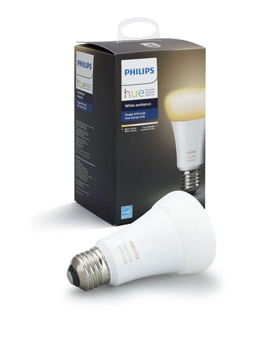 A Philips Hue light bulb laying next to the packaging