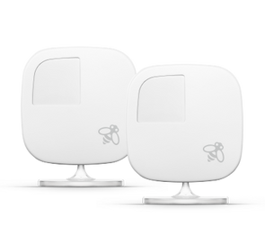 Two white ecobee room sensors on bases
