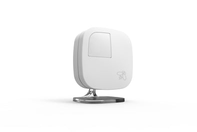 One white ecobee room sensor on a base