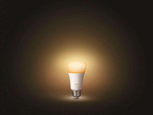 An illuminated Philips Hue light bulb