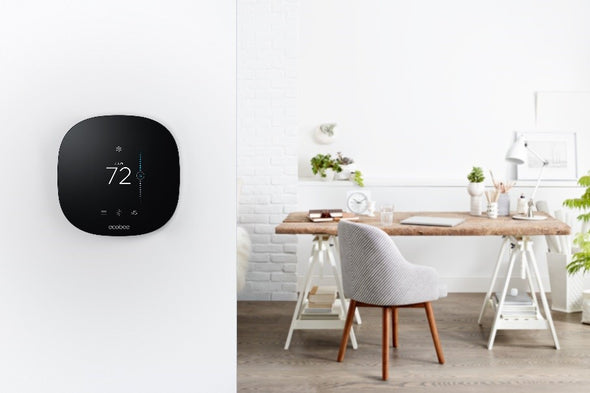 ecobee3 Lite thermostat shown on a wall next to a table and chairs