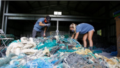 cleaning up plastic nets and other plastic waste  in ocean