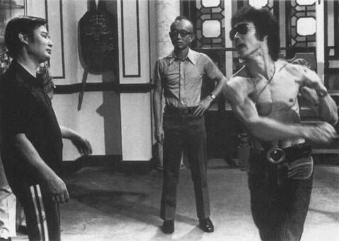 Wong Shun Leung with Bruce Lee on a Golden Harvest movie set
