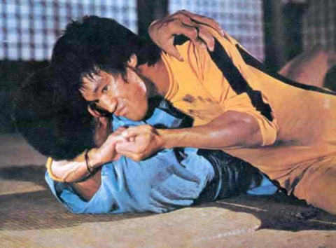 Bruce Lee in Game of Death, using MMA movies before it was cool