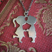 Boy and Girl Kissing 1960s Necklace