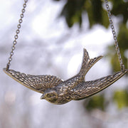 Silver Bird in Flight