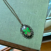Pressed Four Leaf Clover in Resin in Vintage Style Filigree Setting on Antiqued Brass Chain