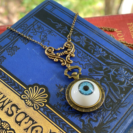 Blue Eye Pendant Necklace in Antique Brass