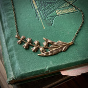 Lilly Necklace in Brass