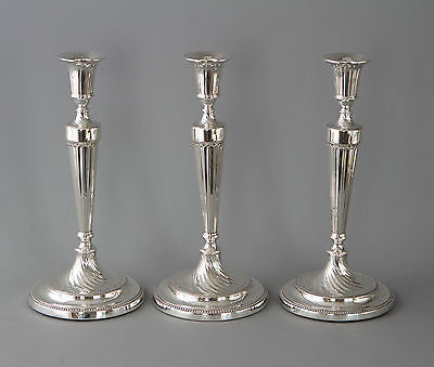 A Fine Set of Three Georgian Silver Candlesticks Sheffield 1781 and 1789