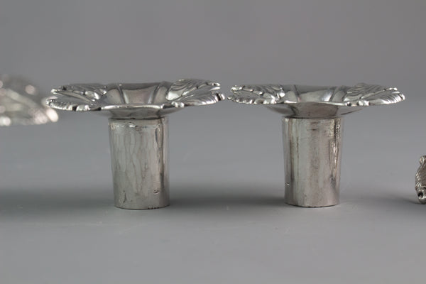 An Exceptional Set of Four Cast Silver Candlesticks London 1764/5