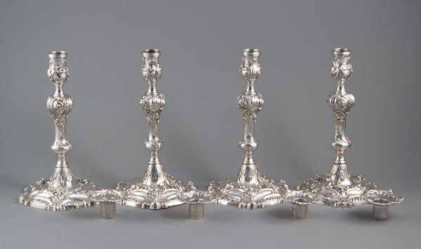 YSL Interest: A set of four cast George II Silver Rococo Candlesticks, London 1757 by John Perry
