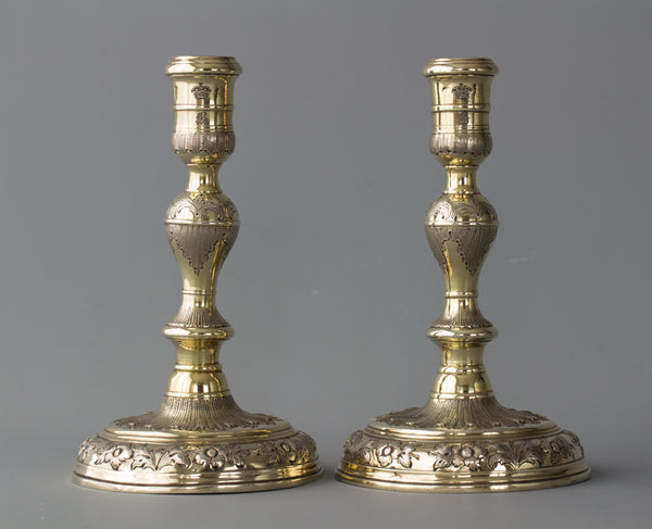 An Elegant Pair of Queen Anne/George I Silver-Gilt Cast Candlesticks by Matthew Cooper