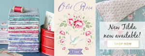 Floral and soft pastel fabric in pinks, teals, blues and reds