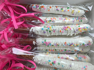 White Chocolate Dipped and Drizzled Chocolate Covered Pretzel Rods with Rainbow Sprinkles