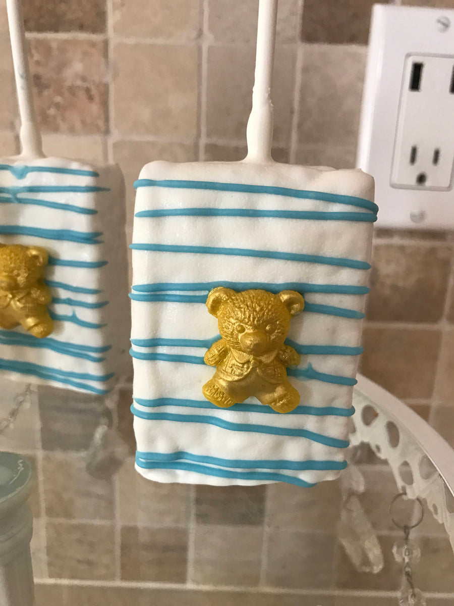 White Dipped Rice Krispies with Light Blue Drizzle and Edible Gold Teddy Bear