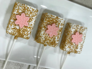 White and Gold Rice Krispie Treats with Edible Pink Snowflake