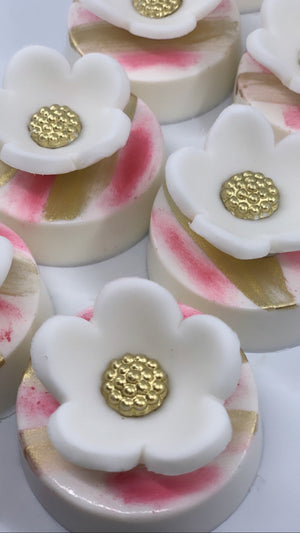 Pink and White Chocolate Covered Oreos with White Flower and Edible Gold Sparkles