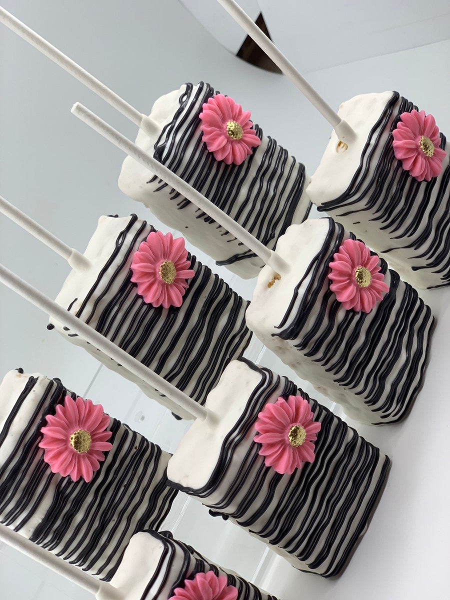 Black White and Pink Decorated Rice Krispie Treats with Gold Sprinkles
