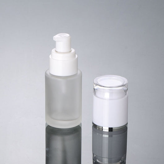 30ml frosted glass bottle with white press pump and white lid with silver band