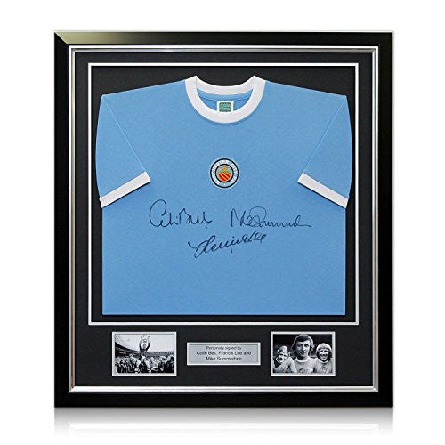 Manchester City Soccer Jersey Signed By Colin Bell, Francis Lee And Mike Summerbee. In Deluxe Black Frame With Silver Inlay