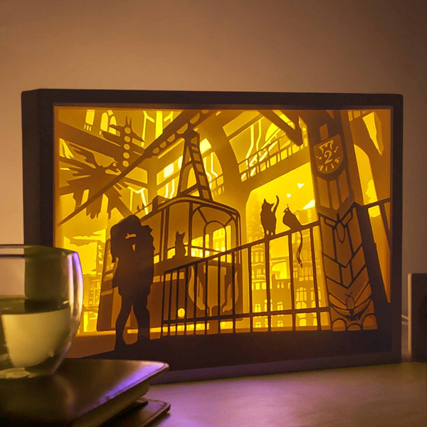 Papercut Light Boxes - Kissing at the top of the city