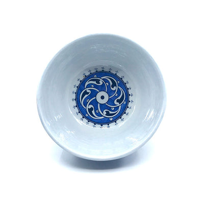 Iznik bowl blue-white rumi pattern on cobalt-blue ground.