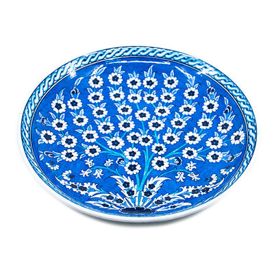 Blue and white iznik plate with Tree of Life design