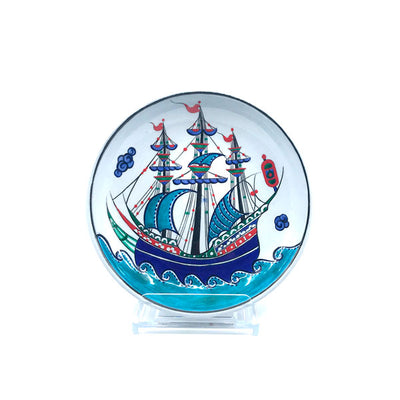 Iznik deep dish decorated with blue ship design