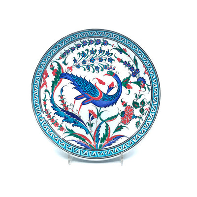 Iznik ceramic deep plate depicting peacock