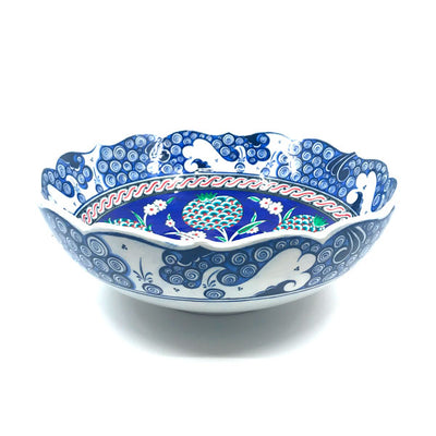 Iznik bowl decorated with pomegranate flowers in cobalt-blue ground