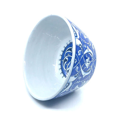 Iznik high bowl blue-white rumi pattern on cobalt-blue ground.
